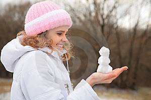 Young Beauty Girl In Winter Holds Small Snowman Royalty Free Stock Photography - Image: 8370667