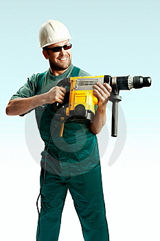 Smiled Workman Drilling With Perforator Stock Photos - Image: 8373623
