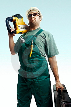 Skeptic Workman With Perforator On The Shoulder Royalty Free Stock Photo - Image: 8373745