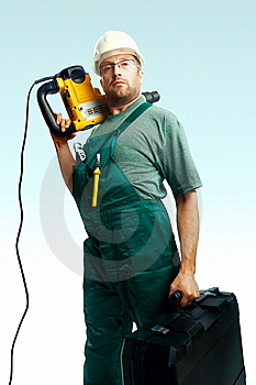 Serious Workman Hold Perforator And Suitcase Stock Image - Image: 8373891