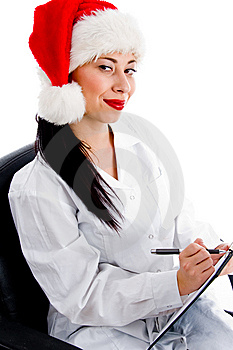 Smart Doctor In Christmas Hat Writing Prescription Stock Photo - Image: 8375820