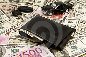 Leather Wallet,keychain,car  On Dollars Royalty Free Stock Image - Image: 8380366