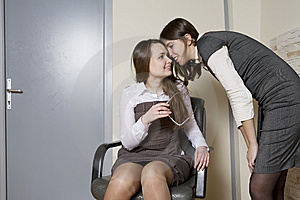 Two Colleagues Discuss Gossip. Royalty Free Stock Images - Image: 8381769