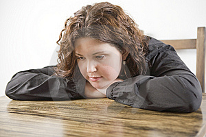 Girl Put Her Head Down Table. Stock Photos - Image: 8382383