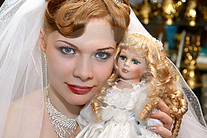 Bride With A Doll Stock Photo - Image: 8399280
