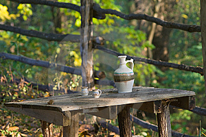 Rustic Table Wit Water Pot Royalty Free Stock Photo - Image: 8401065