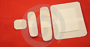Four Bandages On Red Stock Photos - Image: 8403593
