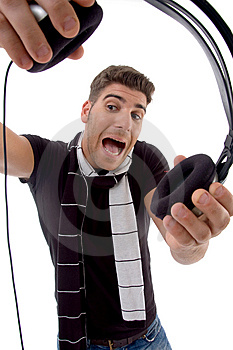 Shouting Male Holding Headphone Royalty Free Stock Image - Image: 8406776