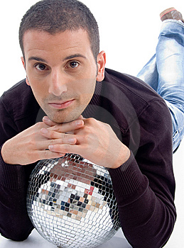 Young Guy Lying With Disco Ball Royalty Free Stock Photography - Image: 8406987
