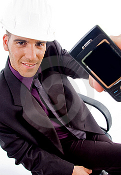 Young Male Architect Showing His Cell Phone Royalty Free Stock Photography - Image: 8407227