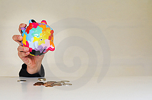 Emptying Money Out Of Piggybank Stock Photo - Image: 8407990