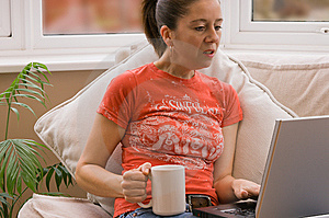 Woman Using Laptop Royalty Free Stock Photography - Image: 8411107