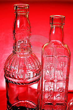 Two Bottles On Red Stock Image - Image: 8413661