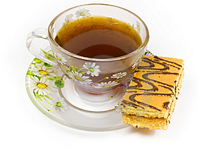 Cap Of Tea On Saucer With Cake Royalty Free Stock Photos - Image: 8414288