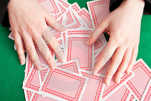 Croupier Mixing Cards On A Table Stock Photography - Image: 8415242