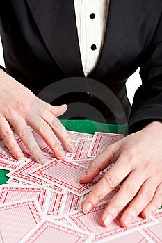Croupier Mixing Cards On A Table Royalty Free Stock Photo - Image: 8415325