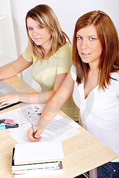 Students Learning At Desk Royalty Free Stock Images - Image: 8417629