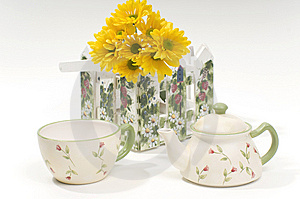 Teapot And Cup With Yellow Flowers Stock Photography - Image: 8428852