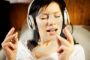 Woman Listening Music And Singing Royalty Free Stock Photos - Image: 8431308