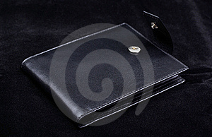 Wallet On Black Velvet. Royalty Free Stock Image - Image: 8432876
