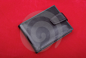 Wallet On Red Velvet. Royalty Free Stock Image - Image: 8432886