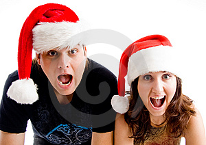 Portrait Of Shouting Couple Wearing Christmas Hat Royalty Free Stock Photos - Image: 8433438