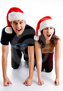 Winking Young Couple Wearing Christmas Hat Stock Photos - Image: 8433443