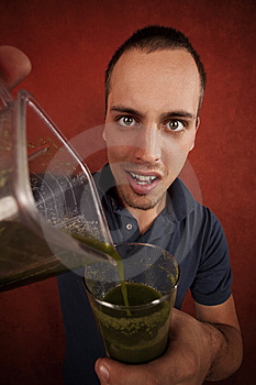 Young Man With Unappetizing Health Shake Royalty Free Stock Image - Image: 8443986