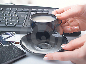 Hand With Cup Royalty Free Stock Photo - Image: 8447315