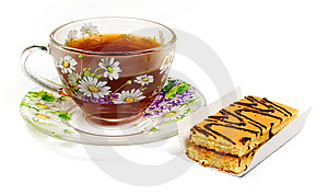 Cap Of Tea On Saucer With Cake Royalty Free Stock Photography - Image: 8454577