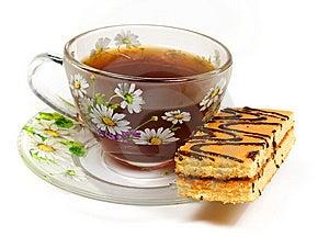 Cap Of Tea On Saucer With Cake Stock Photos - Image: 8454773