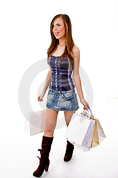 Side View Of Female Carrying Bags And Looking Up Stock Photo - Image: 8456690