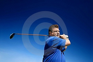 A Man Following Through On A Swing Royalty Free Stock Photo - Image: 8465655