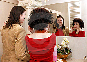 Friends In Front Of A Mirror Royalty Free Stock Photo - Image: 8467205