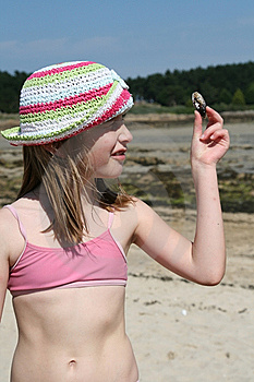 Teenage Girl Looking At A Shell Stock Photos - Image: 8467443