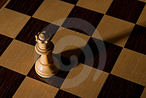 Queen Dramatically Isolated On Chess Board Royalty Free Stock Photography - Image: 8468057
