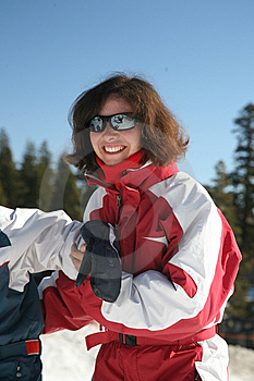 Woman Helping Kid Ski Stock Image - Image: 8469101