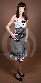 Graceful Girl With A Bag Royalty Free Stock Image - Image: 8474246