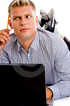 Thinking Man With Laptop And Pencil Royalty Free Stock Image - Image: 8474606