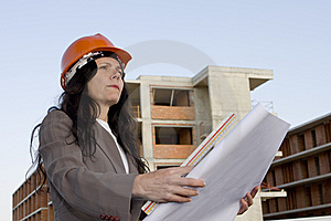 Female Architect Looking At Blueprint Royalty Free Stock Images - Image: 8478509