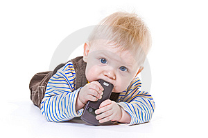 Little Boy Gnawing Cellular Phone Stock Photography - Image: 8489222