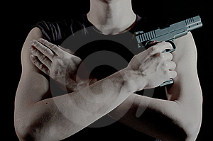 A Man Holds A Pistol Royalty Free Stock Photography - Image: 8491797