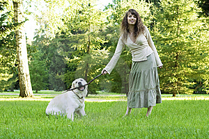 Girl With The Golden Retriever In The Park Royalty Free Stock Photo - Image: 8492005