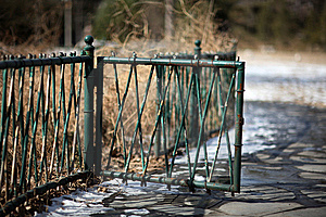 A Green Fencing In Tsinghua University After Snow. Stock Image - Image: 8492351