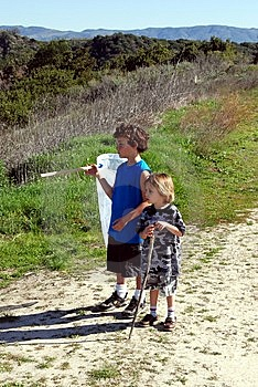 Brother Going On A Bug Hunt Royalty Free Stock Images - Image: 8494079