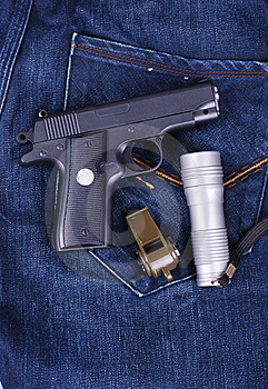 Pistol,flashlight And Whistle On Cloth Of Jean Royalty Free Stock Images - Image: 8494889