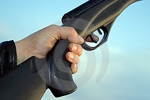 Man Hand Holding Gun Over Sky Stock Image - Image: 8496471