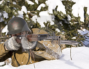 Red Army Soldier Aims From A Rifle Royalty Free Stock Image - Image: 8499726