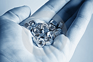 Hand With Bolts And Nuts Royalty Free Stock Photos - Image: 8504378