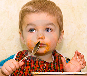 Cute Small Boy Eating Squash Royalty Free Stock Photos - Image: 8507408